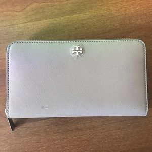 NEVER BEEN USED. Tory Burch travel wallet.